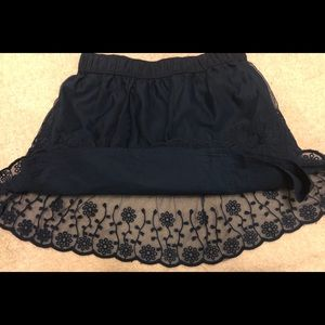 Carters skit with lace and eyelet layers. Size 7
